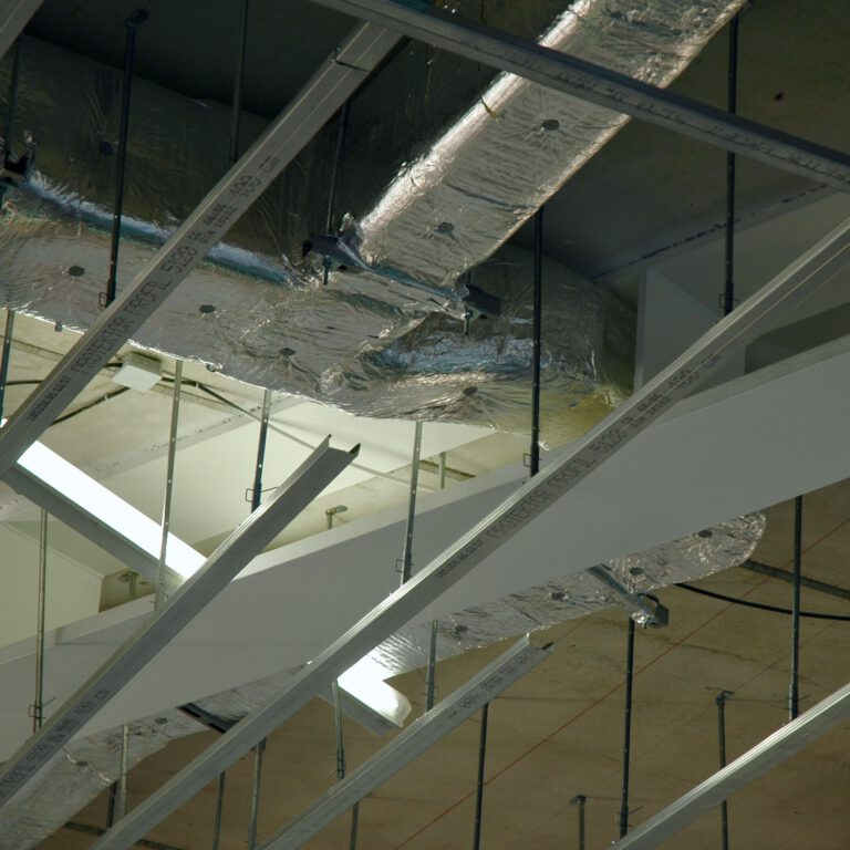 Ceiling of the Arp Museum during Construction with conduits running through Draheim Träger